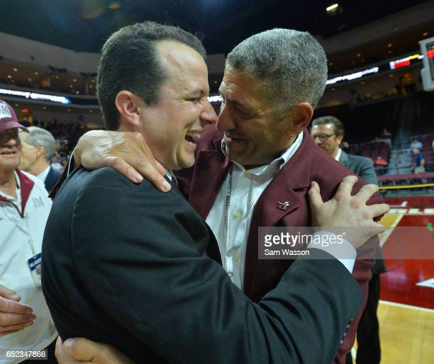 Head coach Paul Weir and Athletic Director Mario Moccia of the New Mexico State Aggies celebrate following the team's 7060 win over the Cal State...