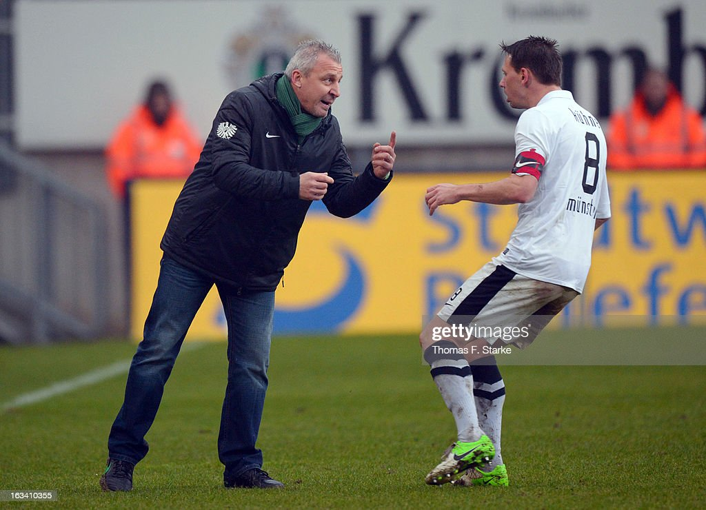 Head coach Pavel Dotchev gives advice to Stefan Kuehne during the Third League match between Arminia Bielefeld and Preussen Muenster at Schueco Arena on March 9, 2013 in Bielefeld, Germany.