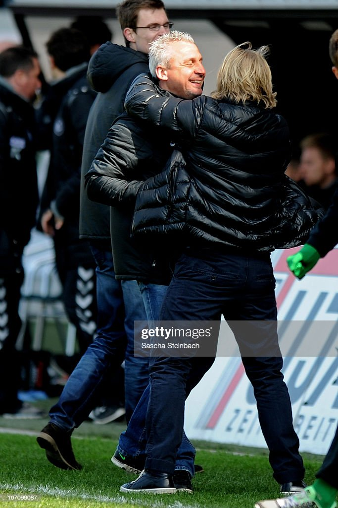 Head coach Pavel Dotchev (L) of Muenster and team coordinater Stephan Kuesters (R) of Muenster celebrates their team's victory after the 3. Liga match between Preussen Muenster and Karlsruher SC at Preussenstadion on April 20, 2013 in Muenster, Germany.