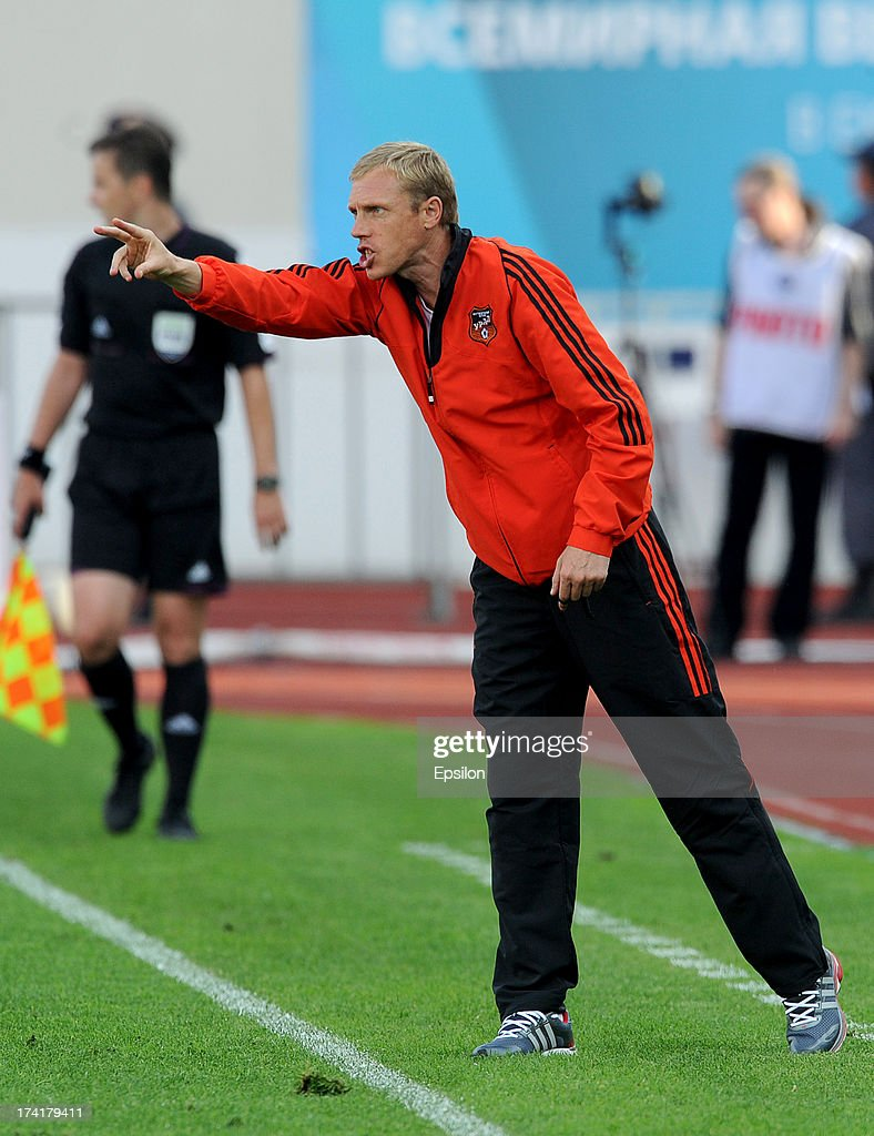 Head coach Pavel Gusev of FC Ural Sverdlovsk Oblast gestures during the Russian Premier League match betweenn FC Ural Sverdlovsk Oblast and FC Spartak Moscow at the Tcentralny Stadium on July 21, 2013 in Ekaterinburg, Russia.
