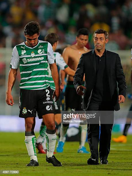 Head coach Pedro Caixinha and Oswaldo Alanis of Santos leave the field dejected after a defeat during a match between Santos Laguna and America as...