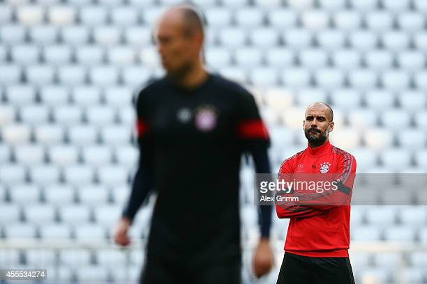 Head coach Pep Guardiola and Arjen Robben attend the FC Bayern Muenchen training session ahead of their UEFA Champions League Group E match against...