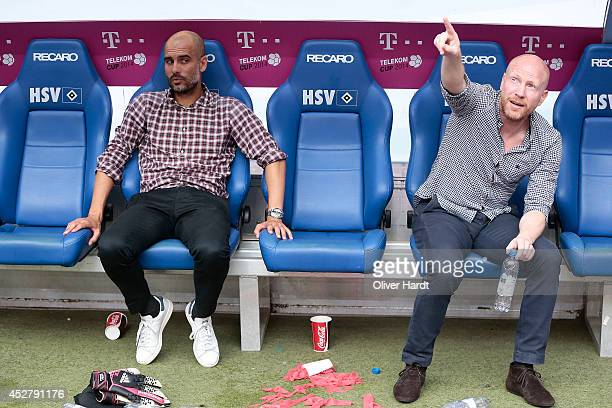 Head coach Pep Guardiola and Matthias Sammer of Munich after the Telekom Cup 2014 Finale match between FC Bayern Muenchen and Borussia...