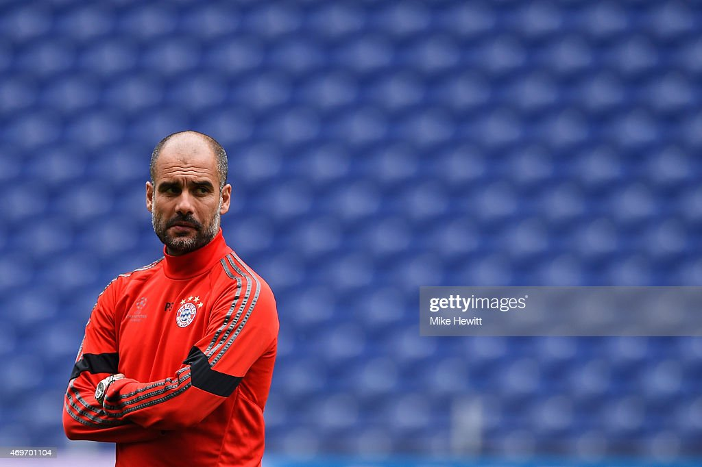 Head coach Pep Guardiola looks on during a FC Bayern Muenchen Training Session ahead of the UEFA Champions League Quarter-Final First Leg match between Porto and FC Bayern Muenchen at Estadio do Dragao on April 14, 2015 in Porto, Portugal.