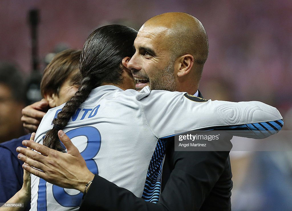 Head coach Pep Guardiola (R) of Barcelona embraces <a gi-track='captionPersonalityLinkClicked' href=/galleries/search?phrase=Jose+Manuel+Pinto&family=editorial&specificpeople=708358 ng-click='$event.stopPropagation()'>Jose Manuel Pinto</a> after a victory in the Copa del Rey Final match between Athletic Bilbao and Barcelona at Vicente Calderon Stadium on May 25, 2012 in Madrid, Spain.
