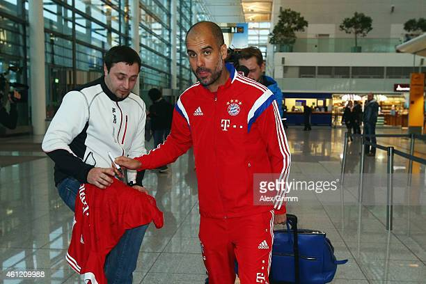Head coach Pep Guardiola of Bayern Muenchen arrives at the airport for the departure to the team's training camp in Doha Qatar on January 9 2015 in...