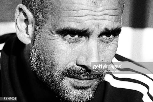 Head coach Pep Guardiola of Bayern Muenchen looks on during the friendly match between SG Sonnenhof Grossaspach and FC Bayern Muenchen at Comtech on...