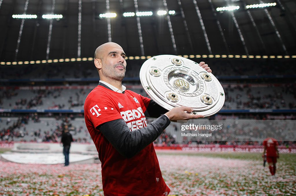 Head coach Pep Guardiola of Muenchen celebtrate with the Bundesliga trophy after winning the league during the Bundesliga match between FC Bayern Muenchen and 1. FSV Mainz 05 at Allianz Arena on May 23, 2015 in Munich, Germany.