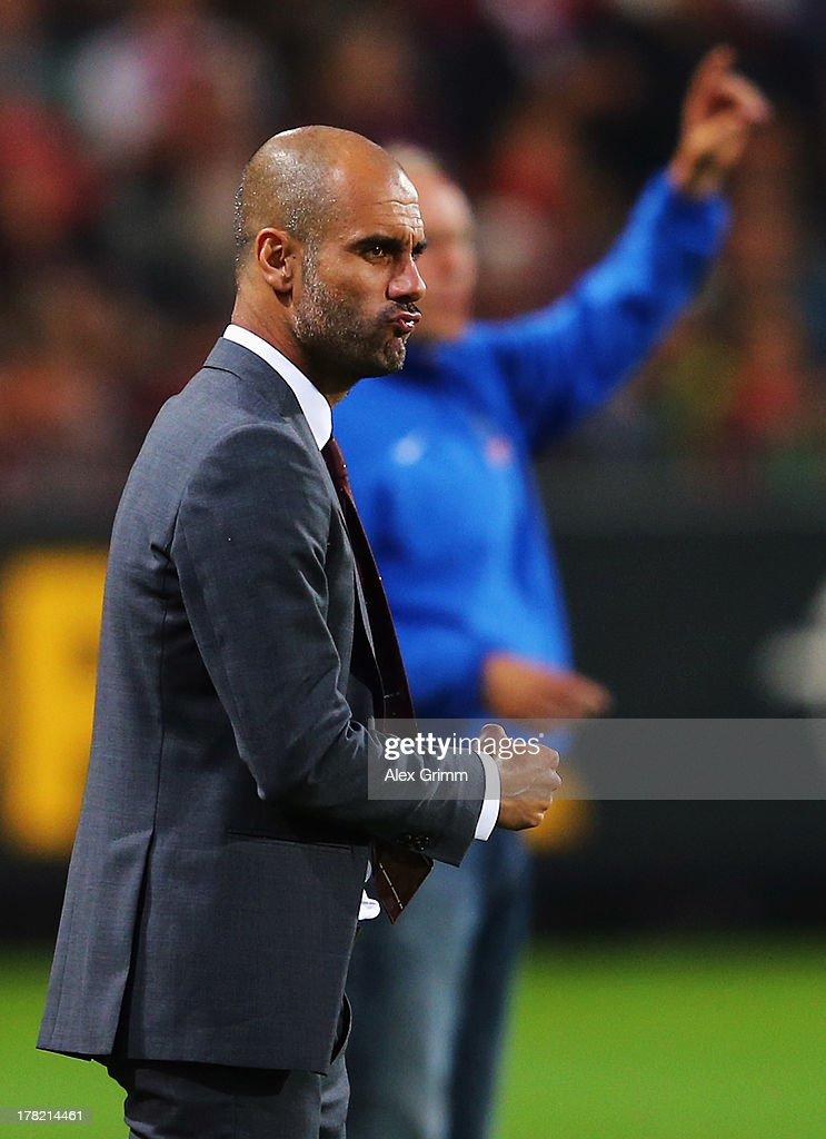 Head coach Pep Guardiola of Muenchen frowns during the Bundesliga match between SC Freiburg and FC Bayern Muenchen at MAGE SOLAR Stadium on August 27, 2013 in Freiburg im Breisgau, Germany.