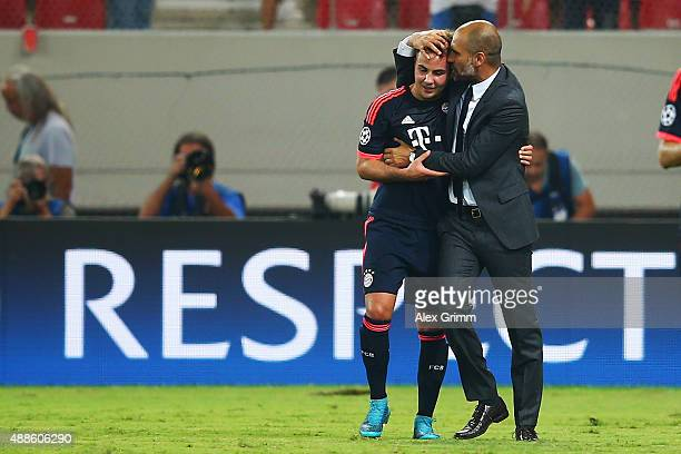 Head coach Pep Guardiola of Muenchen hugs Mario Goetze after the UEFA Champions League Group F match between Olympiacos FC and FC Bayern Muenchen at...