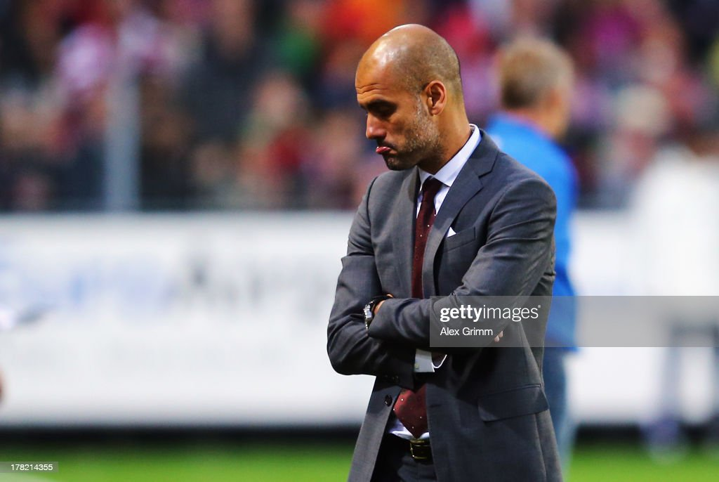 Head coach Pep Guardiola of Muenchen reacts during the Bundesliga match between SC Freiburg and FC Bayern Muenchen at MAGE SOLAR Stadium on August 27, 2013 in Freiburg im Breisgau, Germany.