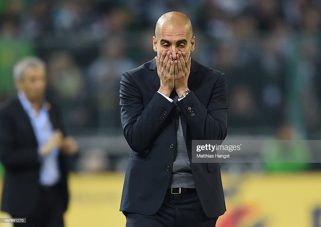 Head coach Pep Guardiola of Muenchen reacts during the Bundesliga match between Borussia Moenchengladbach and FC Bayern Muenchen at Borussia Park on October 26, 2014 in Moenchengladbach, Germany.