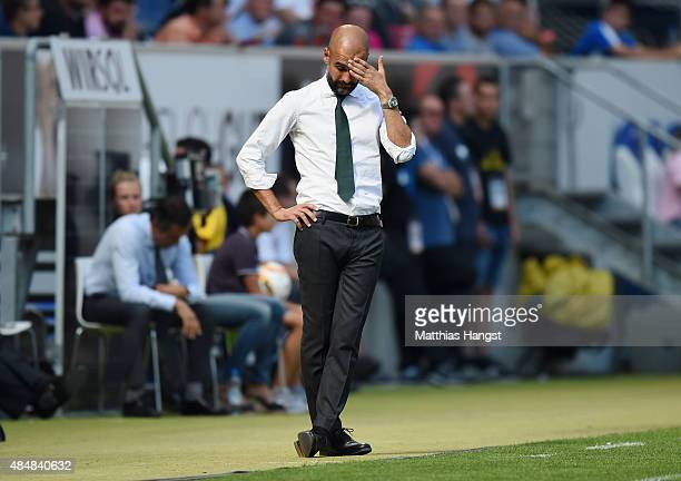 Head coach Pep Guardiola of Muenchen shows his disappointment during the Bundesliga match between 1899 Hoffenheim and FC Bayern Muenchen at Wirsol...