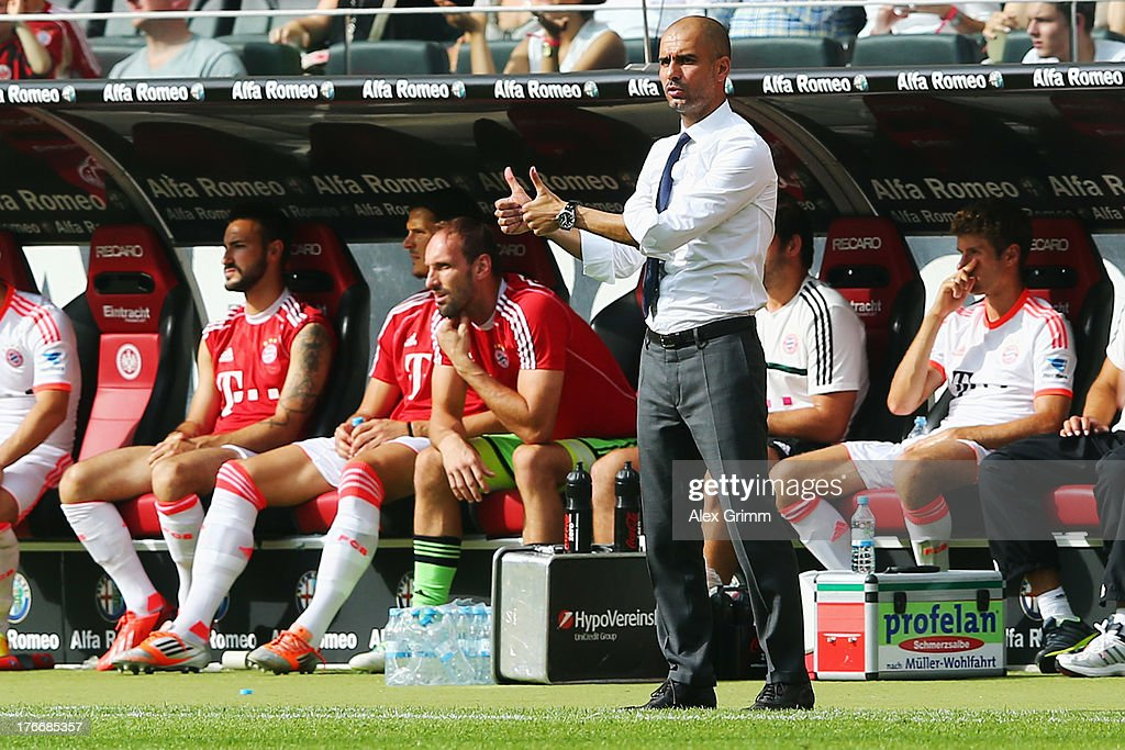 Head coach Pep Guardiola of Muenchen shows thumbs up during the Bundesliga match between Eintracht Frankfurt and FC Bayern Muenchen at Commerzbank Arena on August 17, 2013 in Frankfurt am Main, Germany.