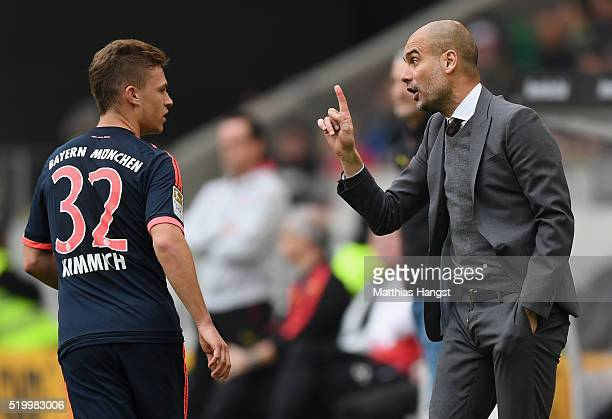 Head coach Pep Guardiola of Muenchen speaks with Joshua Kimmich of Muenchen during the Bundesliga match between VfB Stuttgart and FC Bayern Muenchen...