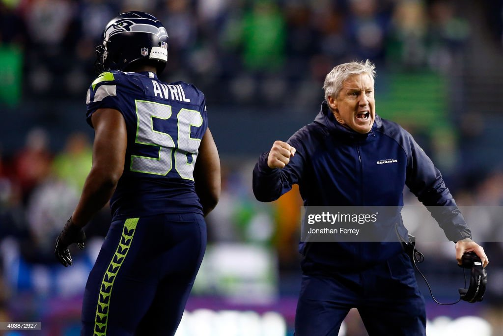 Head coach <a gi-track='captionPersonalityLinkClicked' href=/galleries/search?phrase=Pete+Carroll+-+Head+Coach&family=editorial&specificpeople=213057 ng-click='$event.stopPropagation()'>Pete Carroll</a> and defensive end <a gi-track='captionPersonalityLinkClicked' href=/galleries/search?phrase=Cliff+Avril&family=editorial&specificpeople=2237705 ng-click='$event.stopPropagation()'>Cliff Avril</a> #56 of the Seattle Seahawks celebrate in the fourth quarter while taking on the San Francisco 49ers during the 2014 NFC Championship at CenturyLink Field on January 19, 2014 in Seattle, Washington.