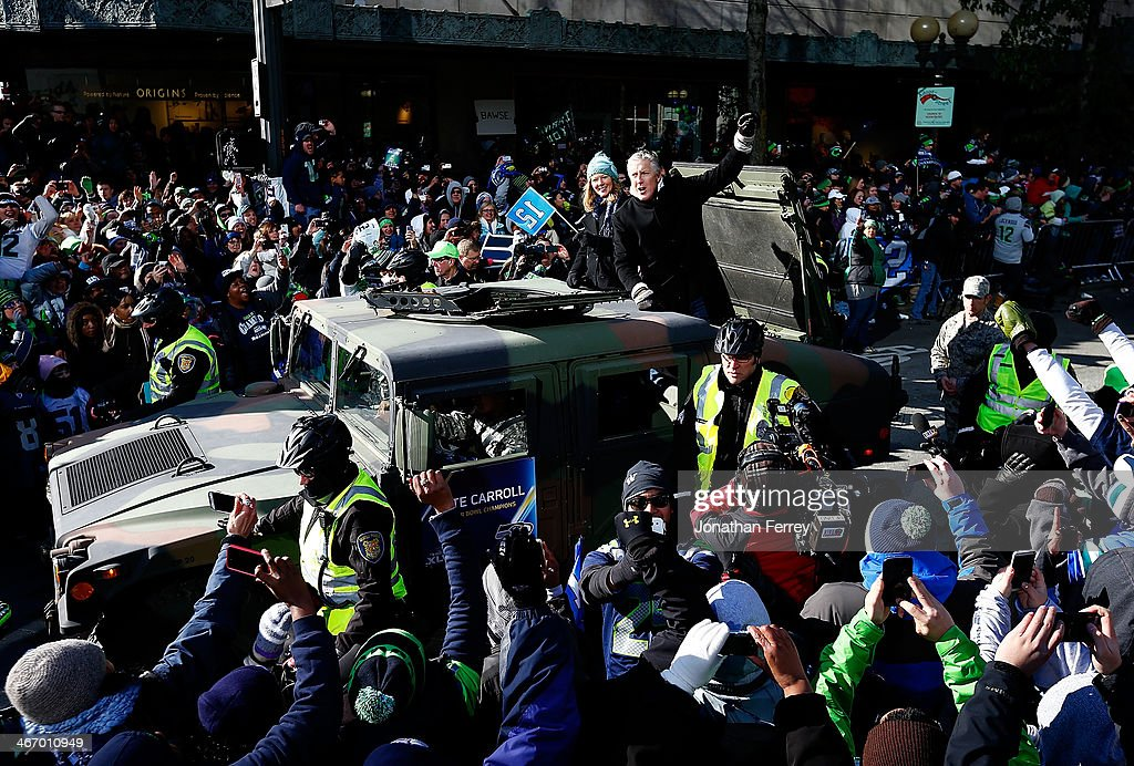 Head coach Pete Carroll of Seattle Seahawks waves to fans during a parade to celebrate their victory in Super Bowl XLVII on February 5, 2014 in Seattle, Washington.