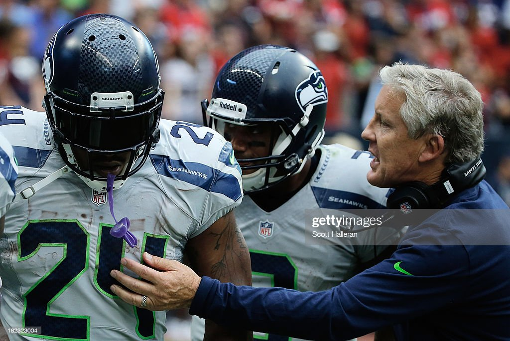 Head coach Pete Carroll of the Seattle Seahawks celebrates a touchdown in the second half by Marshawn Lynch #24 against the Houston Texans at Reliant Stadium on September 29, 2013 in Houston, Texas.