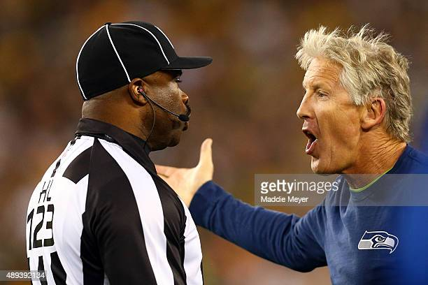 Head coach Pete Carroll of the Seattle Seahawks reacts to line judge Ed Walker after a call in the first quarter in their game against the Green Bay...