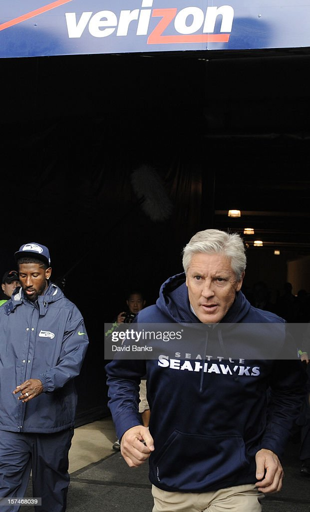 Head coach Pete Carroll of the Seattle Seahawks takes the field before the game against the Chicago Bears on December 2, 2012 at Soldier Field in Chicago, Illinois.The Seattle Seahawks defeated the Chicago Bears 23-17 in overtime.