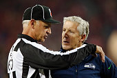 Head coach Pete Carroll of the Seattle Seahawks talks with field judge Gary Cavaletto during a game against the San Francisco 49ers in the third...
