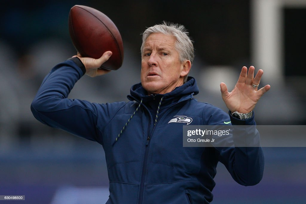 Head coach Pete Carroll of the Seattle Seahawks tosses the football prior to the game against the Arizona Cardinals at CenturyLink Field on December 24, 2016 in Seattle, Washington.
