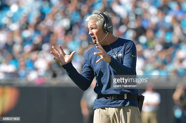 Head coach Pete Carroll of the Seattle Seahawks wears Bose headphones as he watches his team in action against the Carolina Panthers at Bank of...