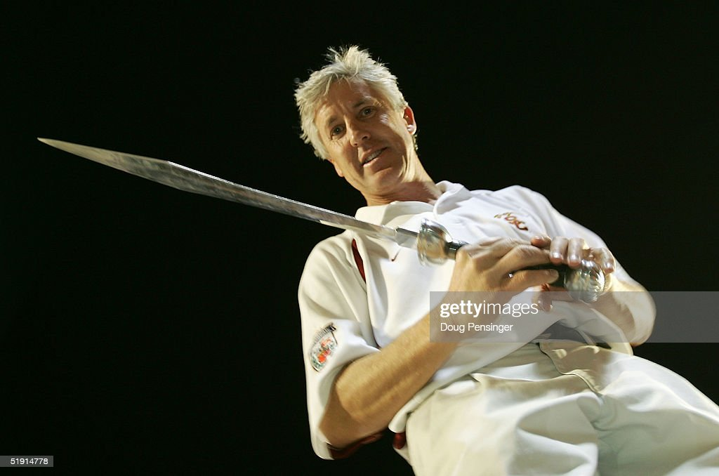 Head coach Pete Carroll of the USC Trojans holds the sword he used to direct the band after defeating the Oklahoma Sooners 55-19 to win the FedEx Orange Bowl 2005 National Championship on January 4, 2005 at Pro Player Stadium in Miami, Florida.