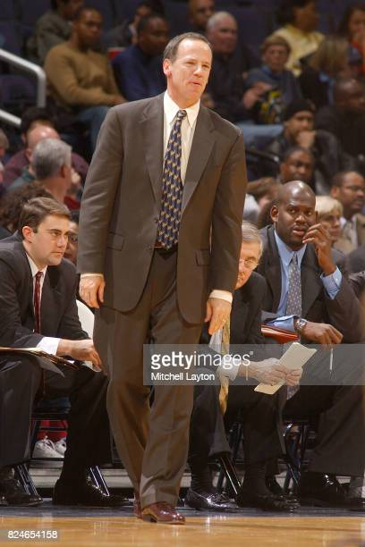 Head coach Pete Strickland of the Coastal Carolina Chanticleers looks on during a college basketball game against the Georgetown Hoyas at MCI Center...