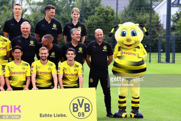 Head coach Peter Bosz and mascot Emma of Borussia Dortmund smile during the team presentation at Brackel Training Ground on August 9 2017 in Dortmund...