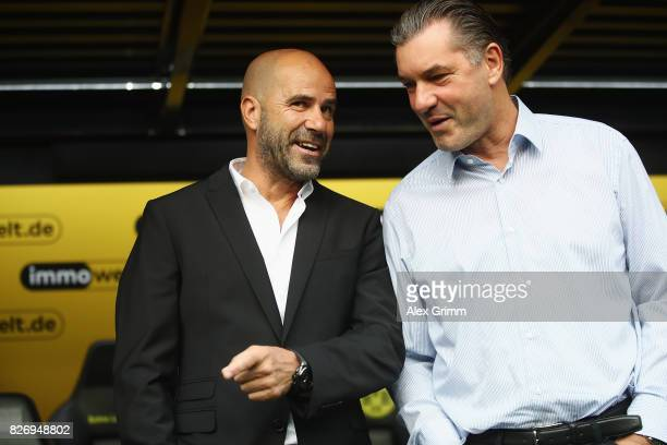 Head coach Peter Bosz and sport director Michael Zorc of Dortmund chat prior to the DFL Supercup 2017 match between Borussia Dortmund and Bayern...