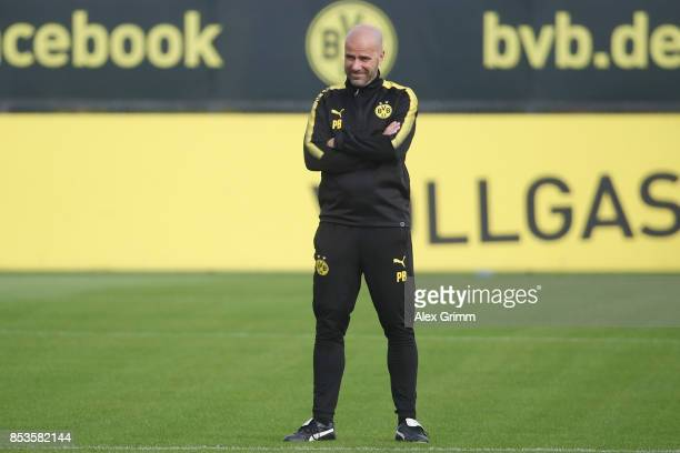 Head coach Peter Bosz looks on during a Borussia Dortmund training session ahead of their UEFA Champions League Group H match against Real Madrid at...