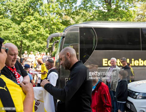 Head coach Peter Bosz of Borussia Dortmund signs autographs prior to the preseason friendly match between RotWeiss Erfurt and Borussia Dortmund at...