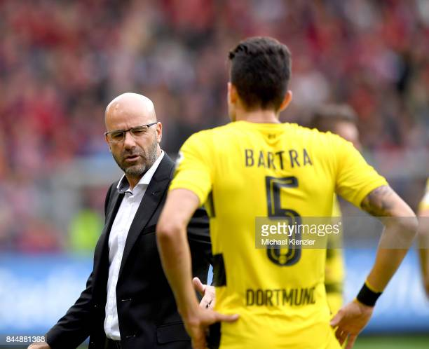 Head coach Peter Bosz of Borussia Dortmund talks to Marc Aregall Bartra during the Bundesliga match between Sport Club Freiburg and Borussia Dortmund...