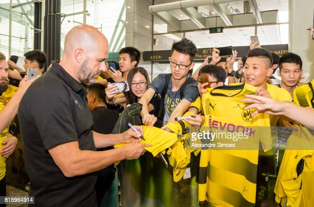 Head coach Peter Bosz of Borussia Dortmund together with the chinese fans which are welcoming the team at the airport during the Borussia Dortmund...