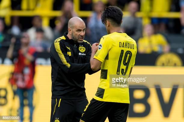 Head coach Peter Bosz of Dortmund and Mahmound Dahoud of Dortmund looks on during the Borussia Dortmund Season Opening 2017/18 at Signal Iduna Park...