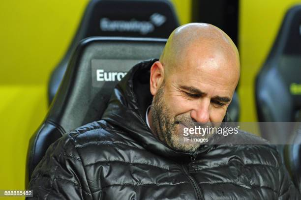 Head coach Peter Bosz of Dortmund closes his eyes prior to the Bundesliga match between Borussia Dortmund and SV Werder Bremen at Signal Iduna Park...