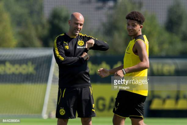 Head coach Peter Bosz of Dortmund gestures Jadon Sancho of Dortmund during a training session at the BVB Training center on September 4 2017 in...