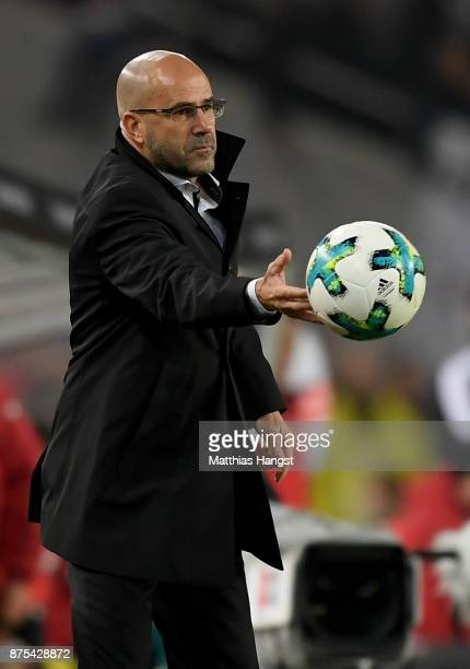 Head coach Peter Bosz of Dortmund is seen with the ball during the Bundesliga match between VfB Stuttgart and Borussia Dortmund at MercedesBenz Arena...
