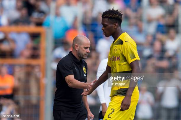 Head coach Peter Bosz of Dortmund shakes hands with DanAxel Zagadou of Dortmund during the preseason friendly match between VfL Bochum and Borussia...