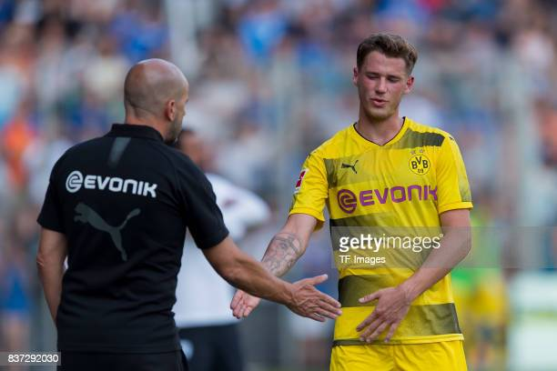 Head coach Peter Bosz of Dortmund shakes hands with Erik Durm of Dortmund during the preseason friendly match between VfL Bochum and Borussia...