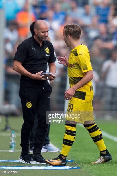 Head coach Peter Bosz of Dortmund shakes hands with Felix Passlack of Dortmund during the preseason friendly match between VfL Bochum and Borussia...