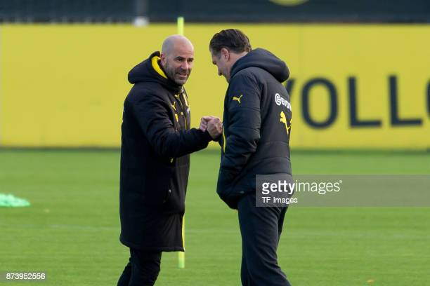 Head coach Peter Bosz of Dortmund shakes hands with Michael Zorc of Dortmund during a training session at BVB trainings center on November 5 2017 in...