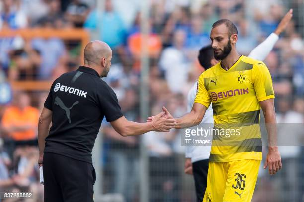 Head coach Peter Bosz of Dortmund shakes hands with Oemer Toprak of Dortmund during the preseason friendly match between VfL Bochum and Borussia...