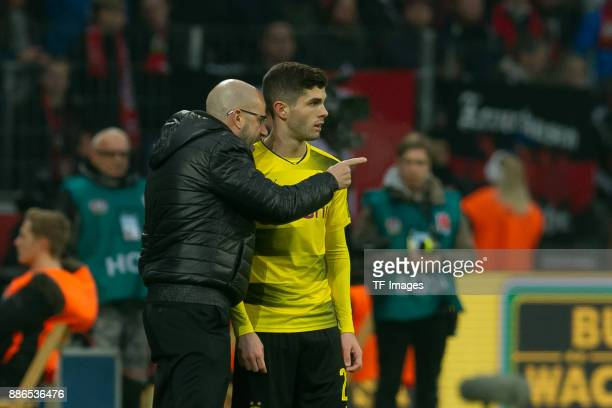 Head coach Peter Bosz of Dortmund speak with Christian Pulisic of Dortmund during the Bundesliga match between Bayer 04 Leverkusen and Borussia...