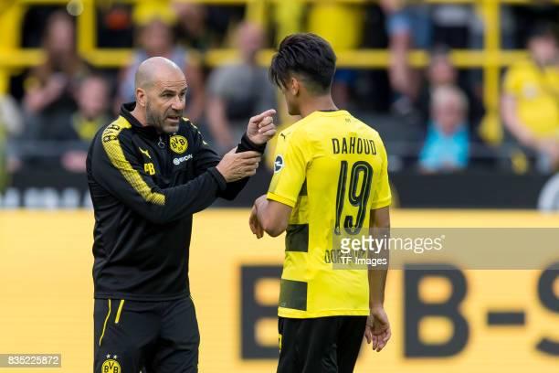 Head coach Peter Bosz of Dortmund speak with Mahmound Dahoud of Dortmund during the Borussia Dortmund Season Opening 2017/18 at Signal Iduna Park on...