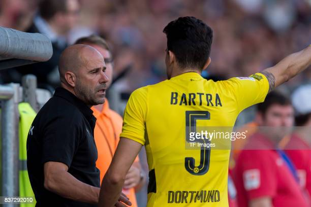 Head coach Peter Bosz of Dortmund speak with Marc Bartra of Dortmund during the preseason friendly match between VfL Bochum and Borussia Dortmund at...