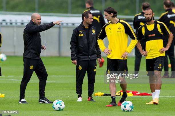 Head coach Peter Bosz of Dortmund speak with Neven Subotic of Dortmund during a training session as part of the training camp on July 27 2017 in Bad...
