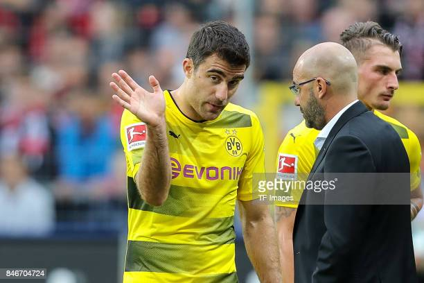 Head coach Peter Bosz of Dortmund speak with Sokratis of Dortmund during the Bundesliga match between SportClub Freiburg and Borussia Dortmund at...