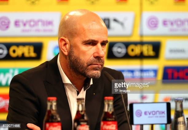 Head coach Peter Bosz of Dortmund speaks on a press conference after the German Bundesliga match between Borussia Dortmund v Bayern Munchen at the...